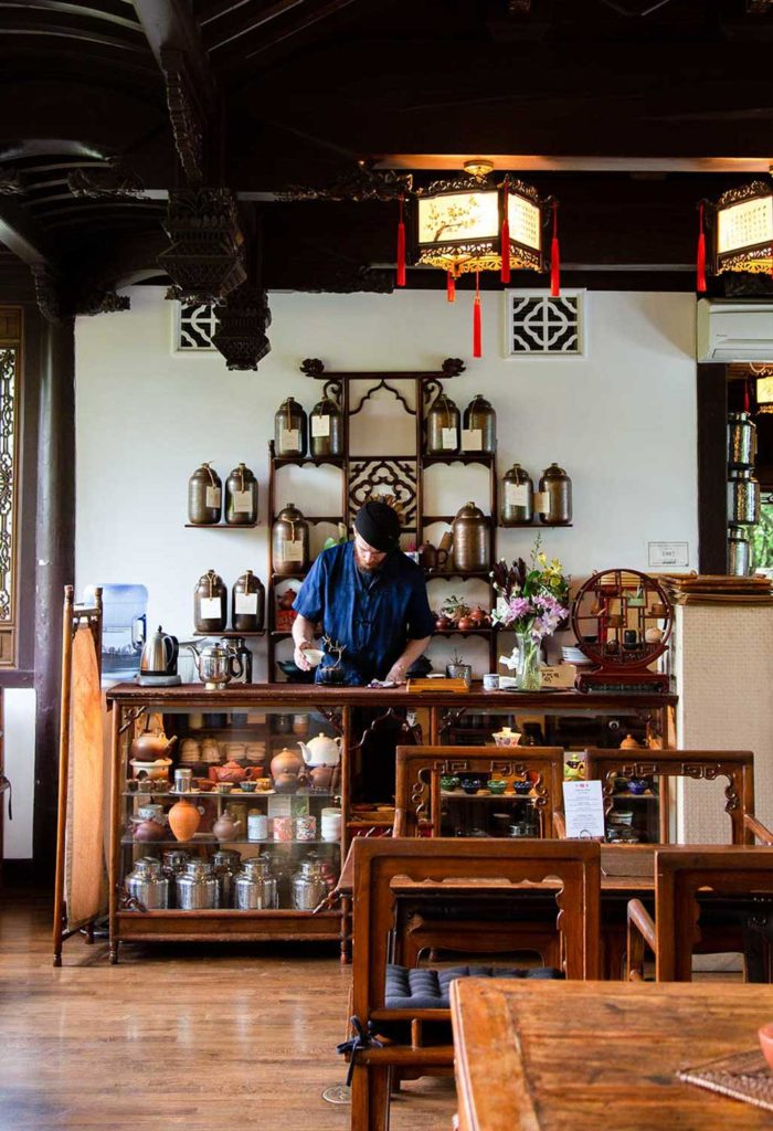 A person working behind the counter of a teashop